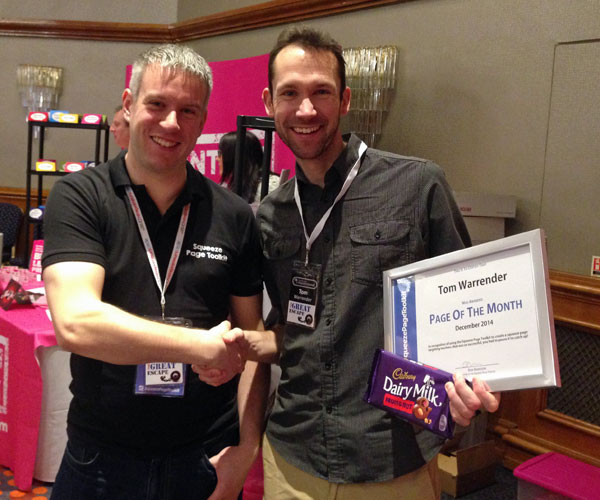 Tom collecting his award from Dan at a conference